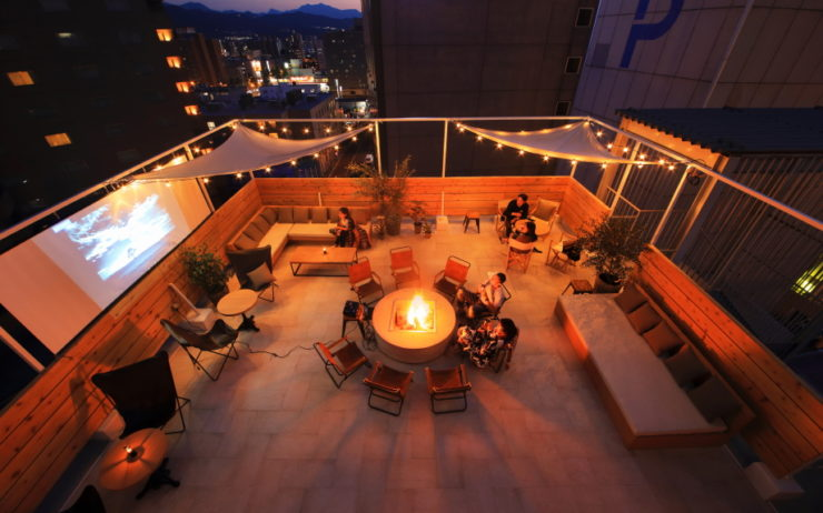 Enjoy the firepit on the rooftop terrace at Unwind Hotel & Bar