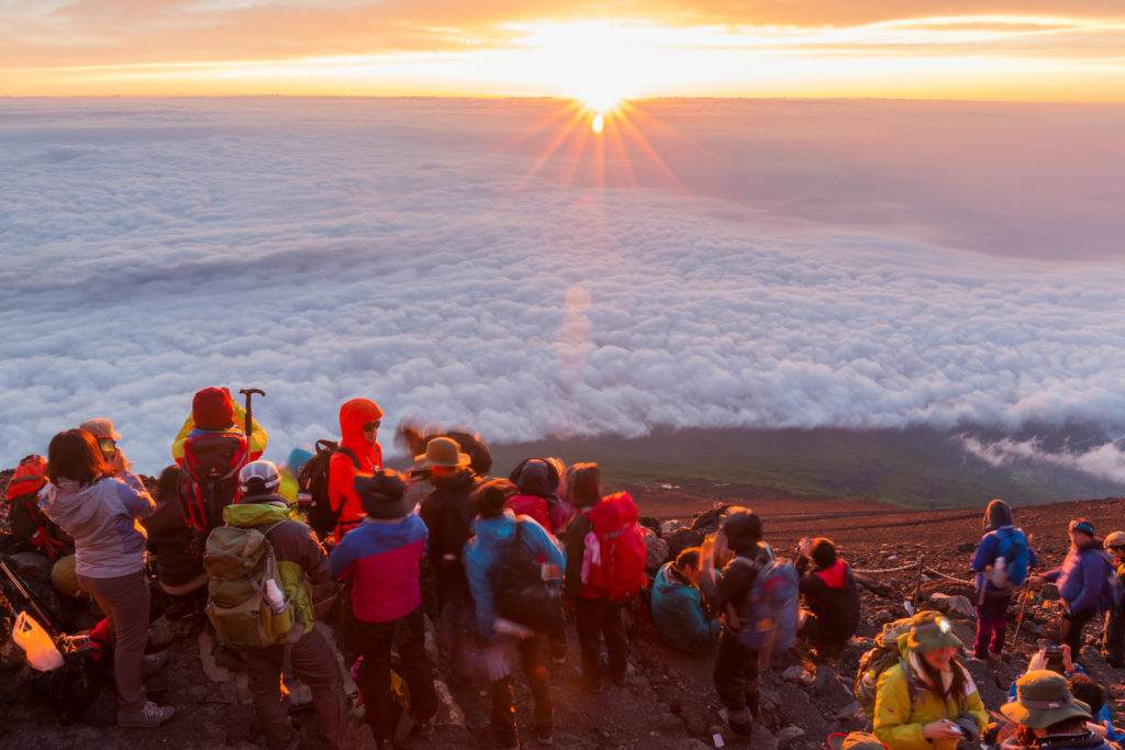 Crowds of climbers at the summit of Mt. Fuji