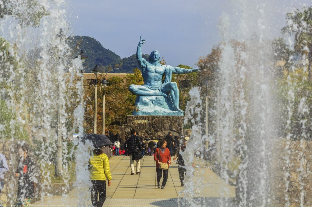 The Peace Statue in Nagasaki Park . The right hand points to the nuclear threat while the left hand represents the wish for peace.