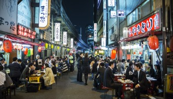 People eating and drinking in Yurakucho Tokyo Japan.