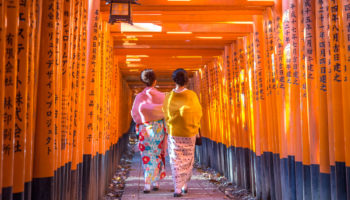 Kyoto, Japan - December 13, 2014: Two geishas walking through orange gates called torii at the Fushimi Inari Shrine (Kyoto, Japan - December 13, 2014: Two geishas walking through orange gates called torii at the Fushimi Inari Shrine, ASCII, 116 compon