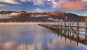 Lake Chuzenji (Chuzenjiko, 中禅寺湖) near Nikko in Japan. Photographed on a beautiful still morning in autumn at sunrise.