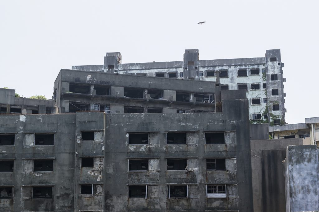 "Hashima Island, commonly called Gunkanjima (meaning ""Battleship Island""), is former coal mining island."