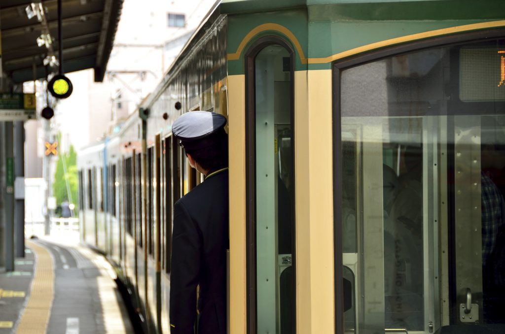 Train conductor on the Enoden railway line in Kamakura.