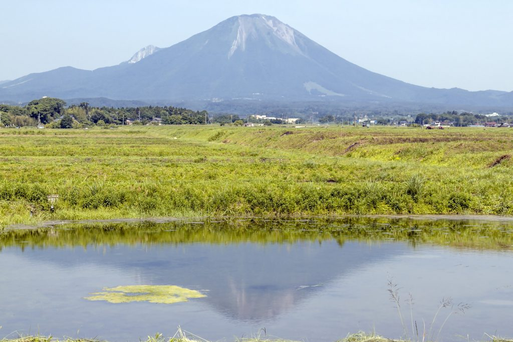 Landscape of mountain reflection of Mount Daisen in a pond