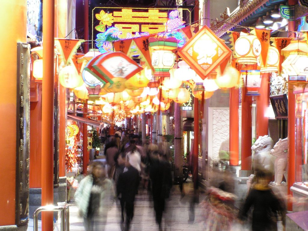 Lanterns hanging inside a shopping arcade.