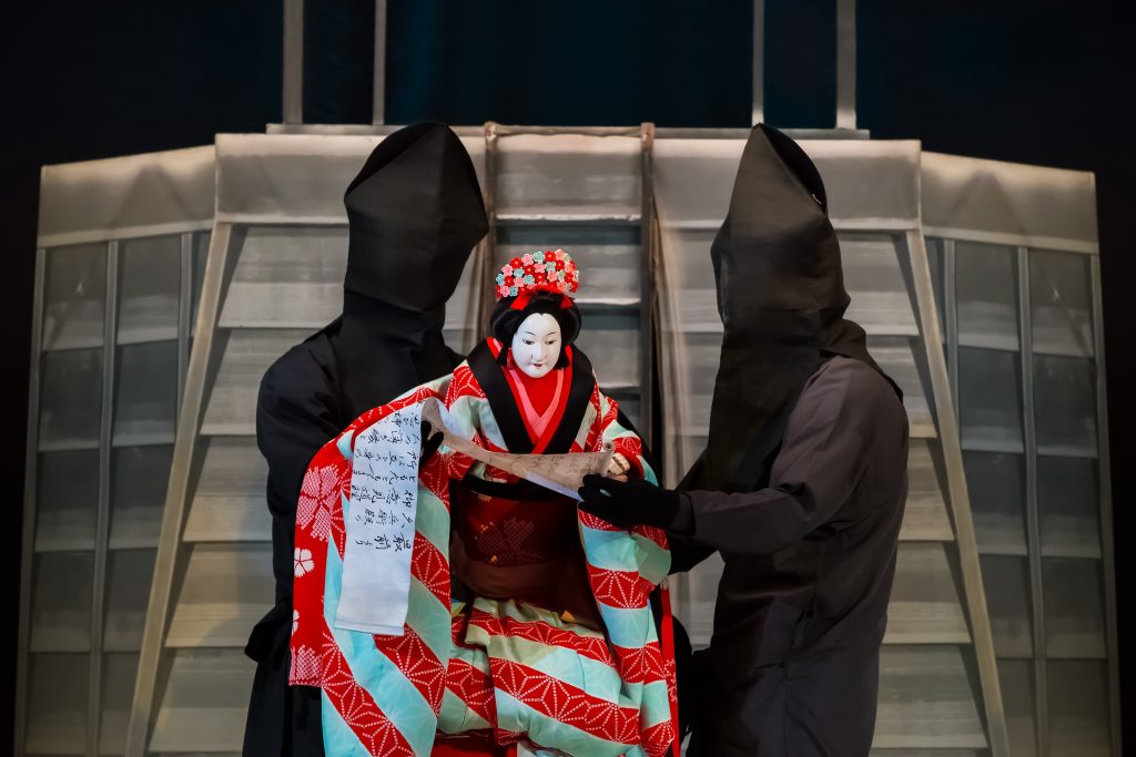 The art of Bunraku or Japanese puppet theatre requires three puppeteers to bring the dolls to life.