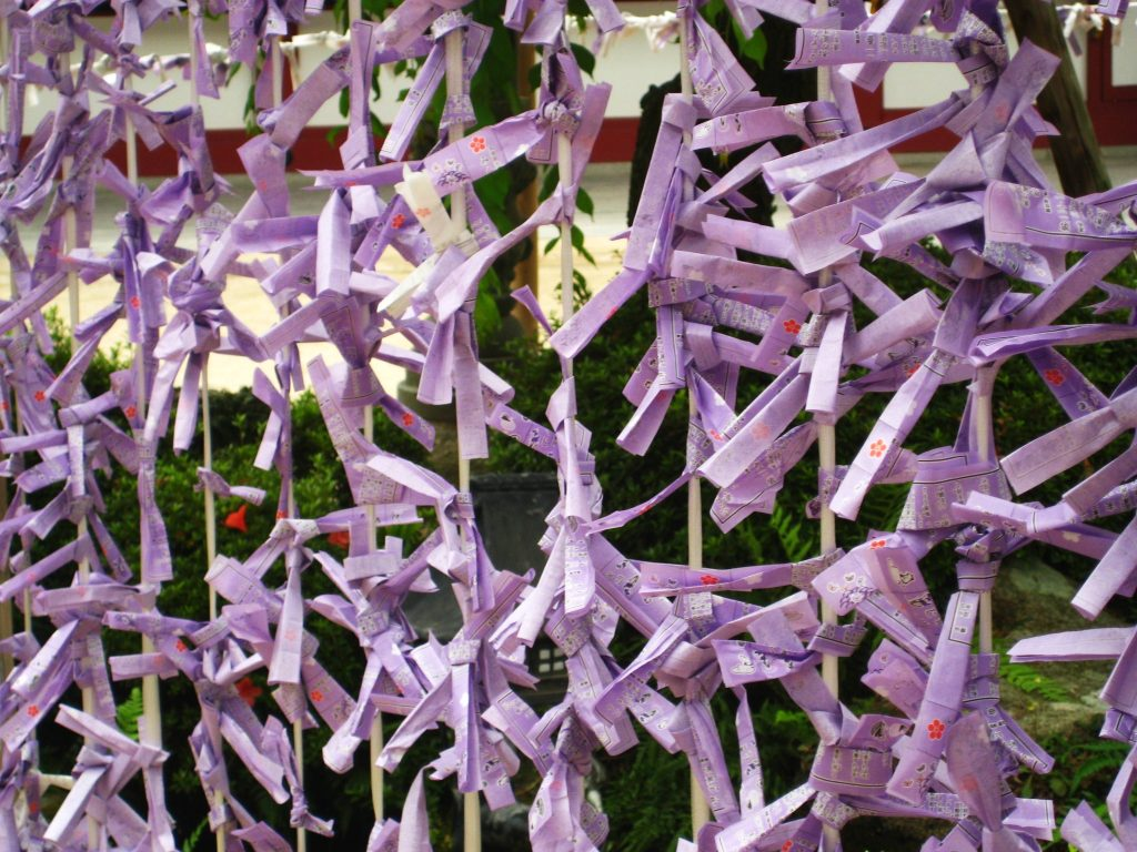 Folded prayer papers at Dazaifu Tenmangu, Fukuoka.