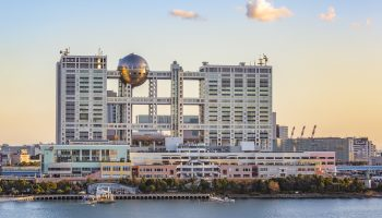 Tokyo, Japan- December 26,2015: Fuji TV Building headquarters at sunset in Odaiba