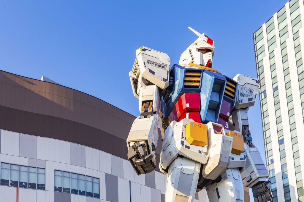 "Tokyo, Japan - 16 February 2015: The 1:1 scale mobile suit Gundam RX78-2 which is 18 metres high from ""Mobile Suit Gundam"".It is located in front of the ""Diver City"" to present the Gundam Front, Tokyo"