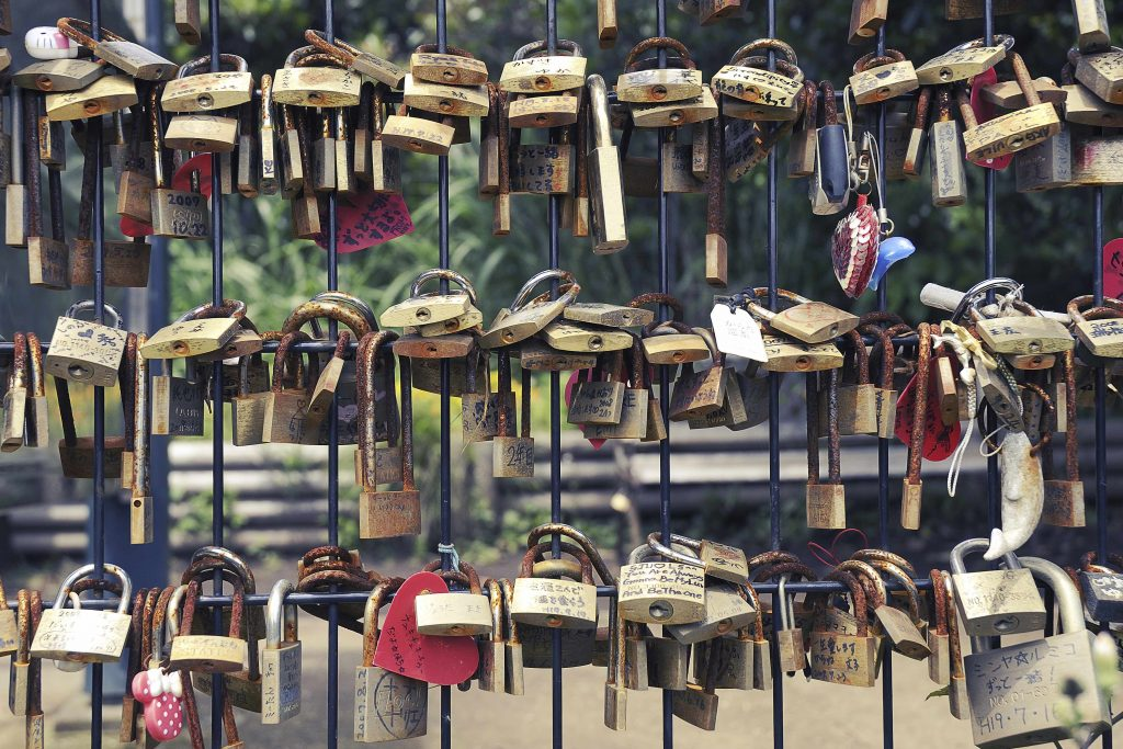 """Enoshima Island, Japan - June 7, 2008 : many love padlocks hanged in the park area of famous Enoshima Island"""