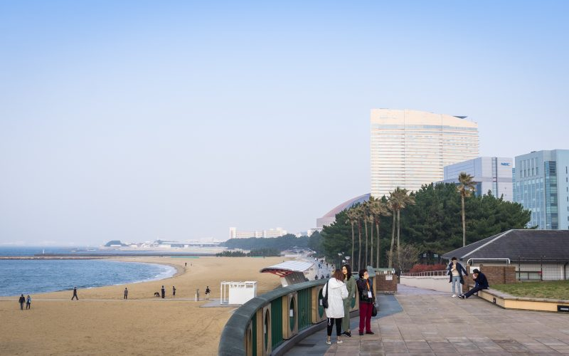 Fukuoka, Japan - March 19, 2016: Tourists are taking picture on the beachside walk of seaside momochi park.