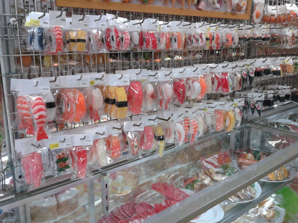 Wall of sushi keyrings in a shop along Kappabashi street,