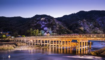 Arashiyama, Kyoto, Japan at Togetsukyo Bridge during the annual autumn light up.
