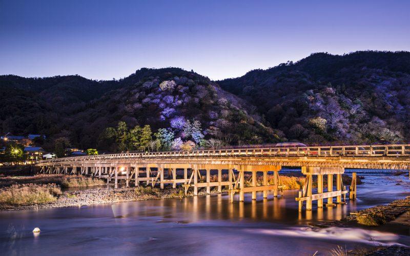 Arashiyama, Kyoto, Japan at Togetsukyo Bridge during the annual autumn light up.