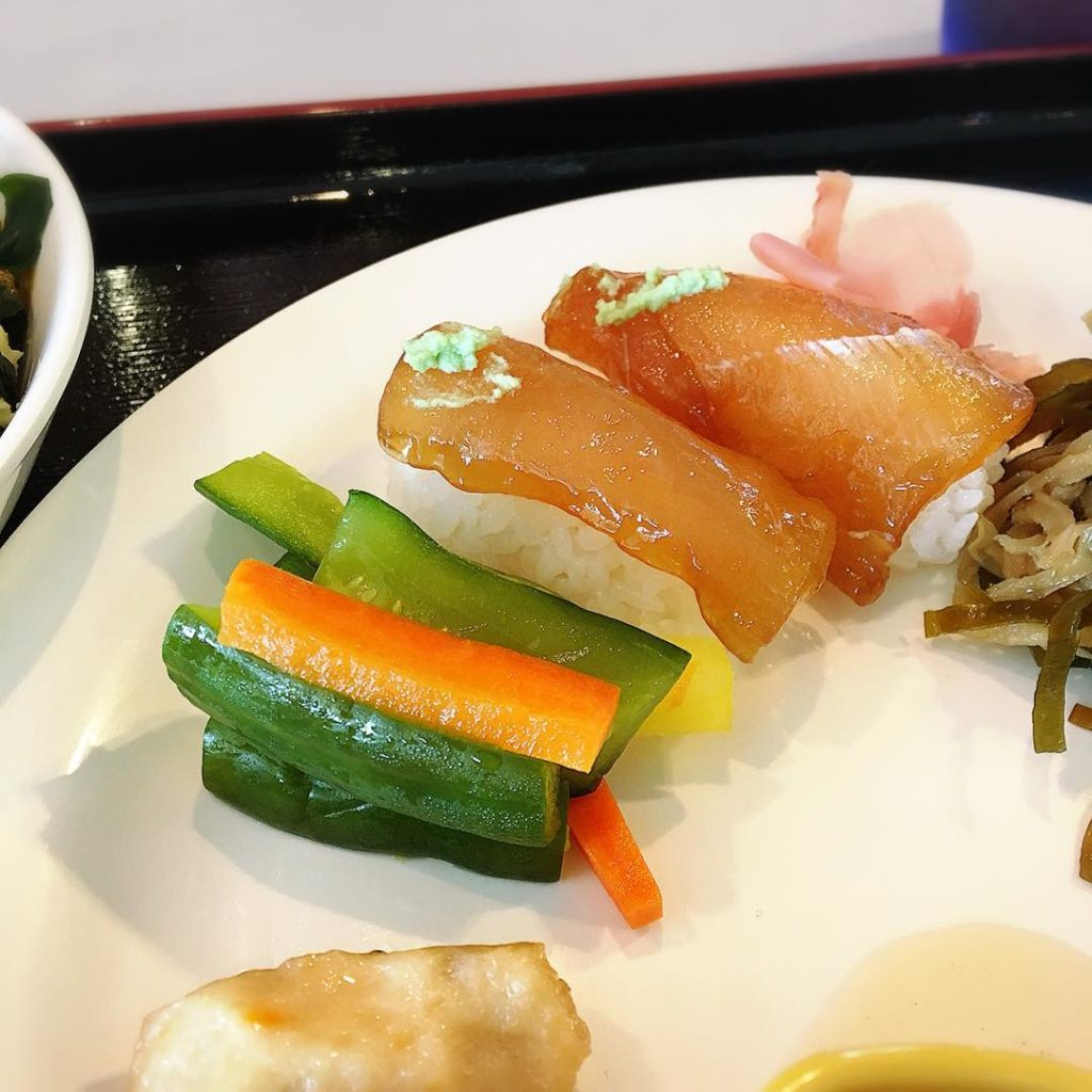 Diato sushi from Minami Daito island with colorful pickles.