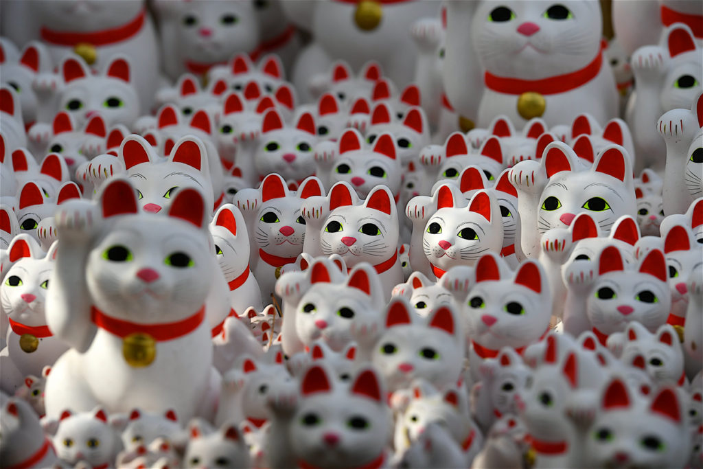 Setagawa,Japan-02 07 2019:Gotokuji, a temple considered at the origin of the well known Maneki-Neko: the cat that welcomes visitors with its right paw up in the air.